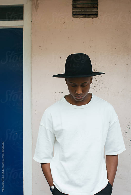 Outdoor Portrait of Young Stylish Black Man With Black Hat Looki by Julien L. Balmer for Stocksy United