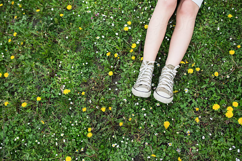 Female legs on the grass by Jovana Rikalo for Stocksy United