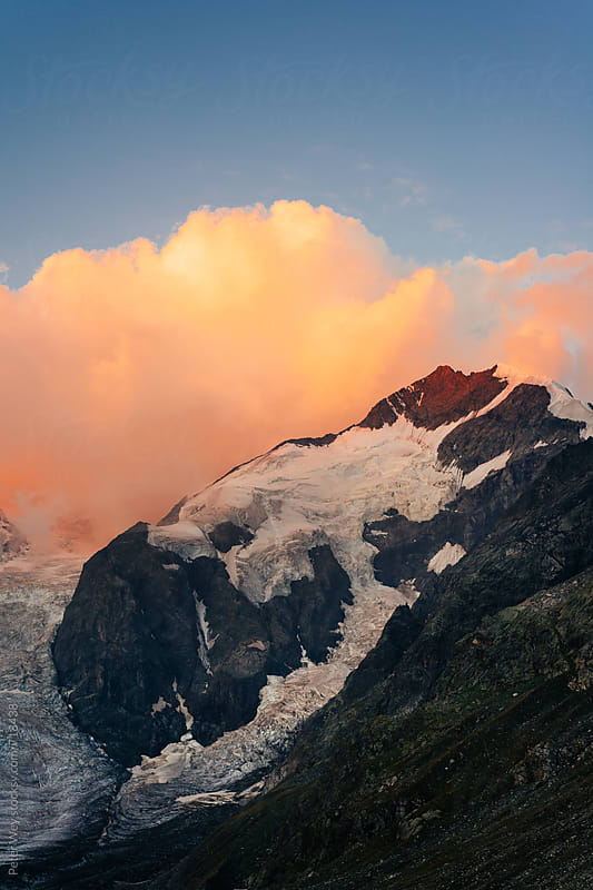Piz Bernina at sunrise by Peter Wey for Stocksy United