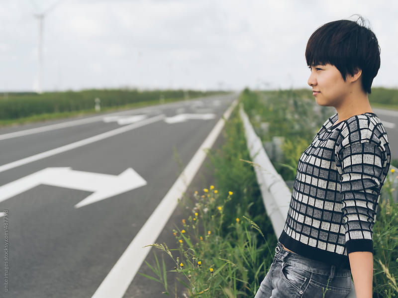 Asian girl stand on the road by unite images for Stocksy United