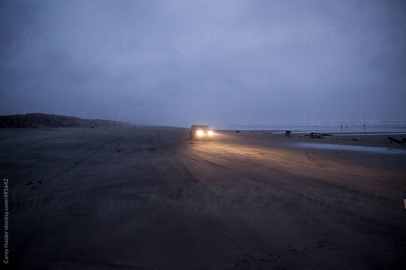 A Car Driving At Night On The Beach by Carey Haider for Stocksy United