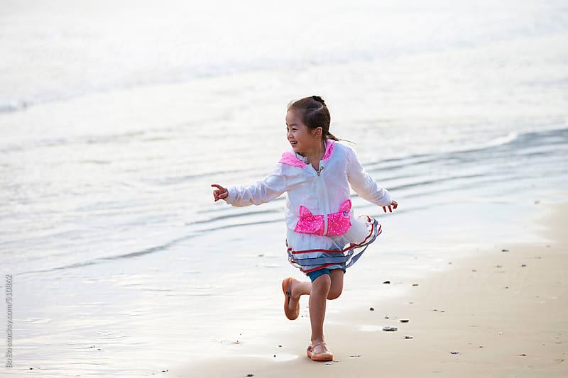 happy asian little girl on beach by Bo Bo for Stocksy United
