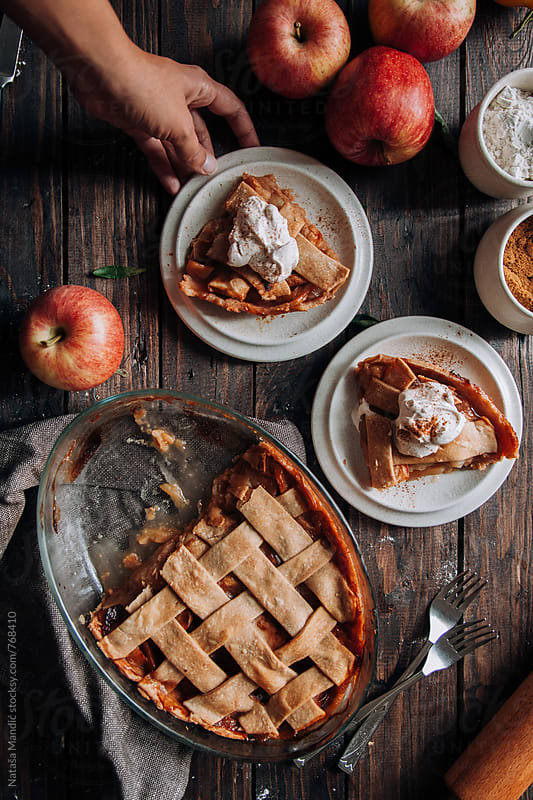 Homemade Apple Pie with whipped cream by Nataša Mandić for Stocksy United