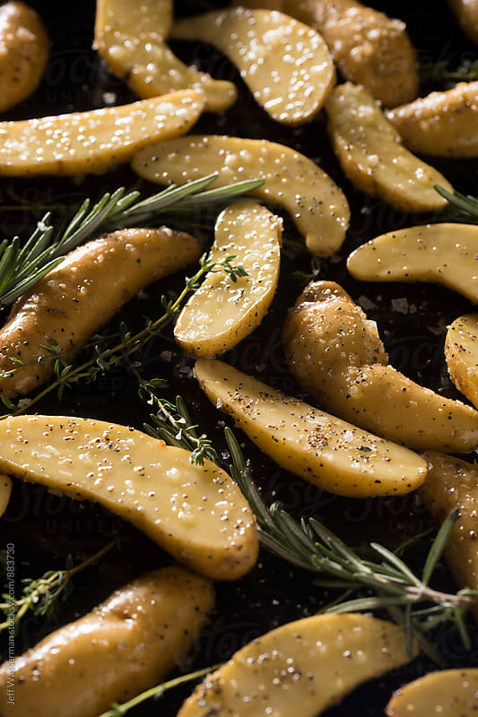 Raw Fingerling Potatoes Ready to Roast by Studio Six for Stocksy United