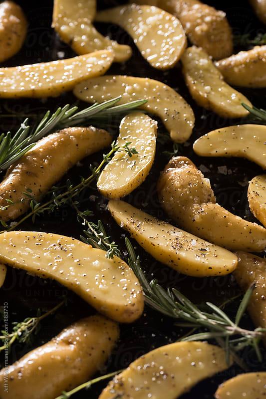 Raw Fingerling Potatoes Ready to Roast by Jeff Wasserman for Stocksy United