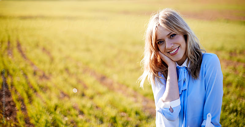 Blonde stylish woman posing at meadow by Guille Faingold for Stocksy United