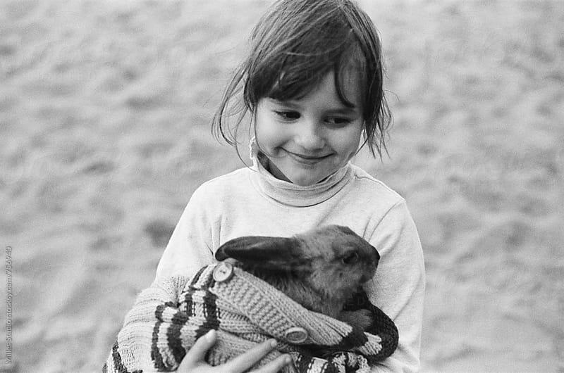 Little girl holding her rabbit by Milles Studio for Stocksy United