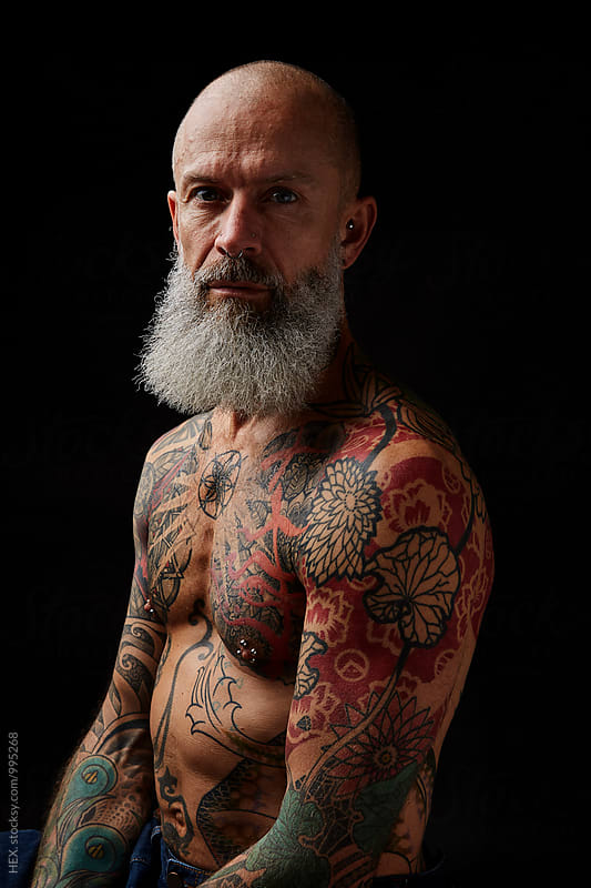 Man With Tatoo Studio Portraits  by Mattia Pelizzari for Stocksy United