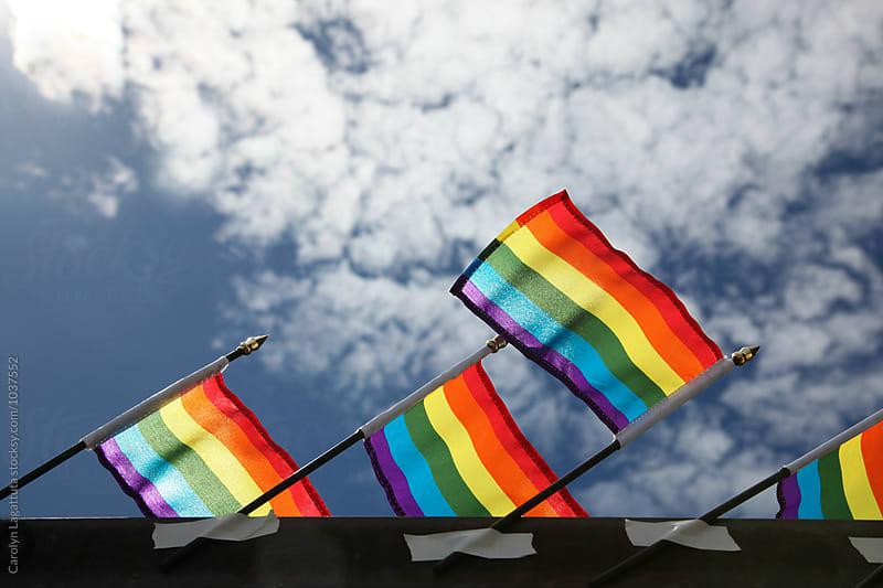 Gay pride flags in support of the LGBTQ community by Carolyn Lagattuta for Stocksy United