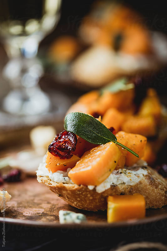 Pumpkin bruschetta by Tatjana Ristanic for Stocksy United