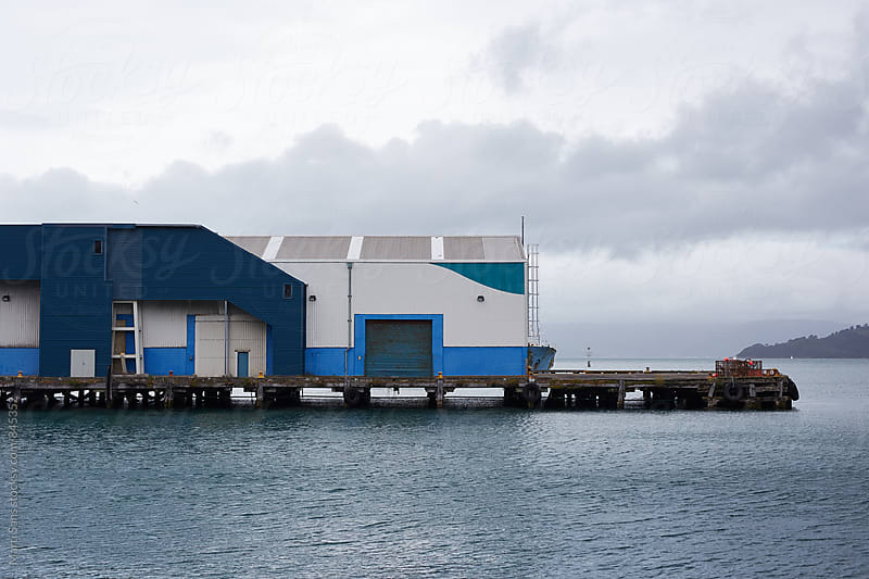 Houses on wharf in cloudy weather by Martí Sans for Stocksy United