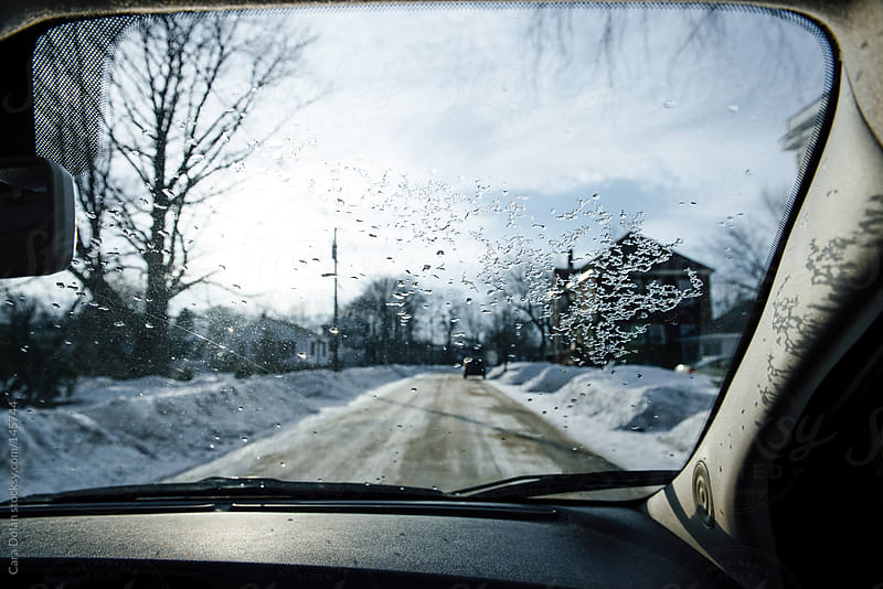 View outside the car window in winter by Cara Dolan for Stocksy United