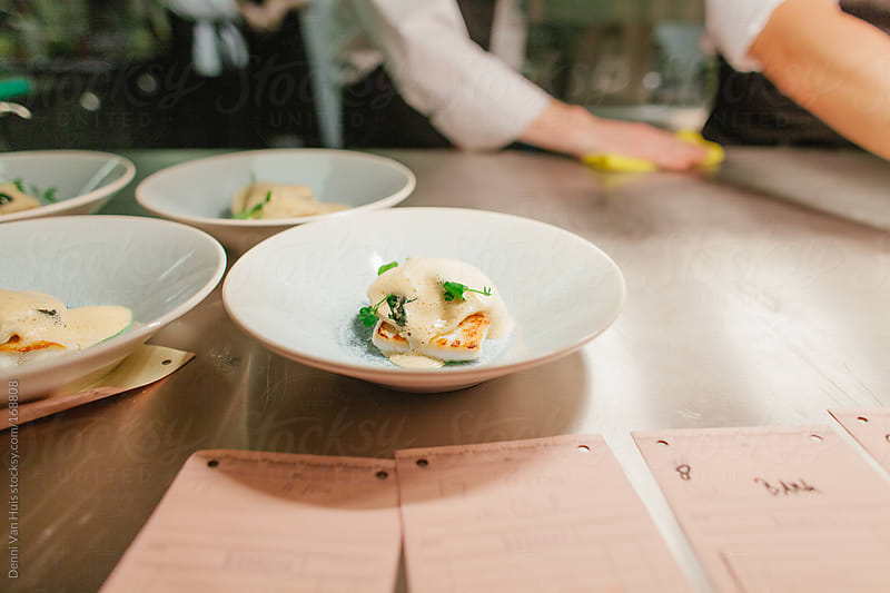 Beautiful dish ready to be served out from a kitchen. by Denni Van Huis for Stocksy United