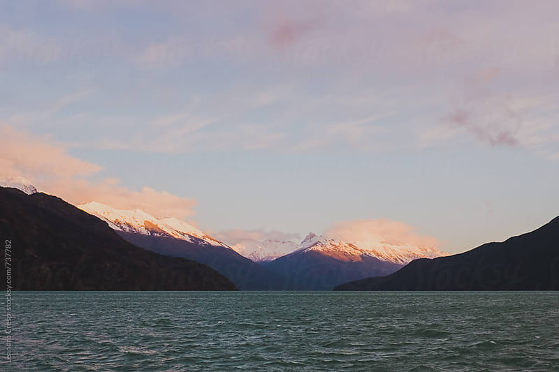 A mountain range in Patagonia seen from a lake by Leandro Crespi for Stocksy United
