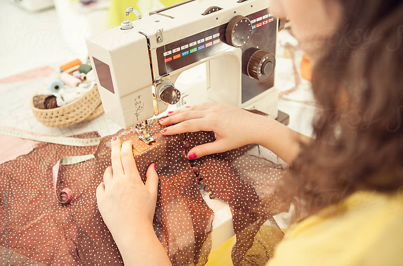 Woman Sewing a Blouse by Mosuno for Stocksy United