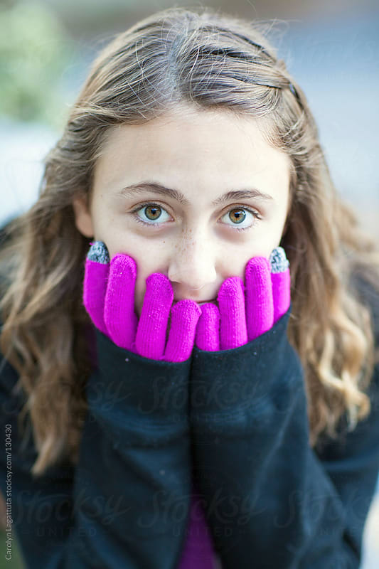 Young California girl with gloves on - not so sure about the cold weather by Carolyn Lagattuta for Stocksy United