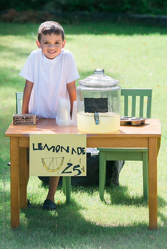 young child working at his lemonade stand  by Tara Romasanta for Stocksy United