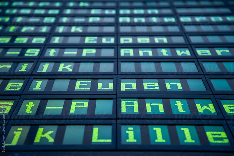 blue display board with fluorescent green letters background by Sonja Lekovic for Stocksy United
