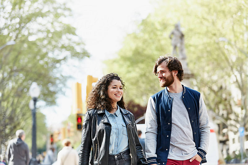 Couple Walking Together In City by ALTO IMAGES for Stocksy United