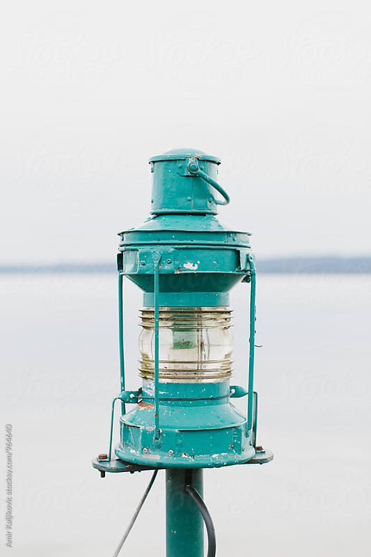 Close-up of painted lantern made of iron  by Amir Kaljikovic for Stocksy United