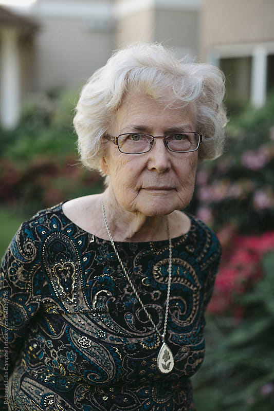 Thoughtful portrait of senior caucasian woman outside by Rob and Julia Campbell for Stocksy United
