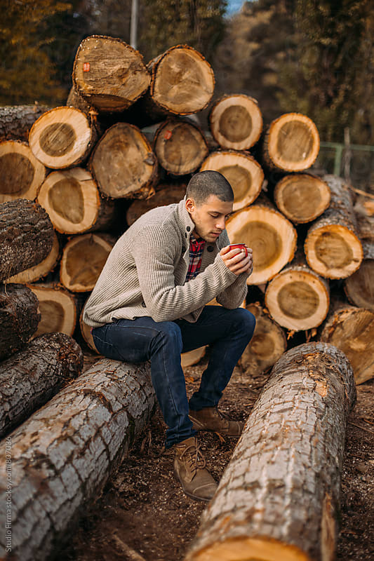 Lumberjack Taking a Break by Studio Firma for Stocksy United