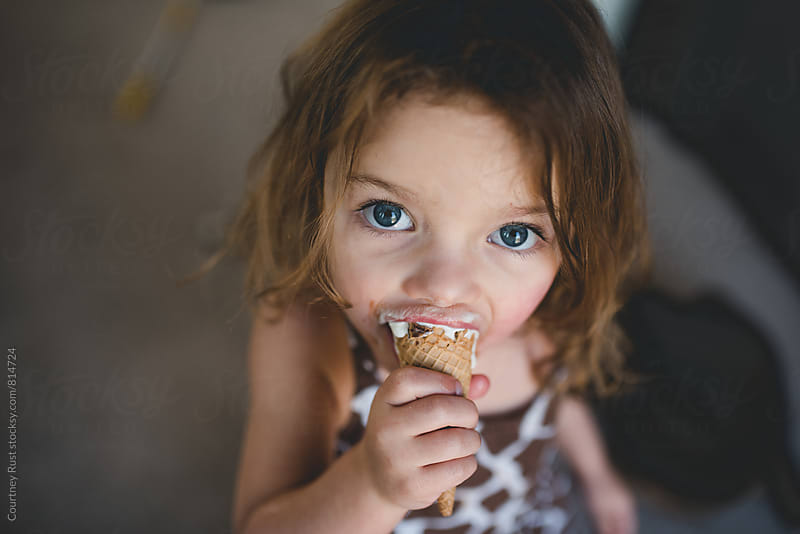 the ice cream stare by Courtney Rust for Stocksy United