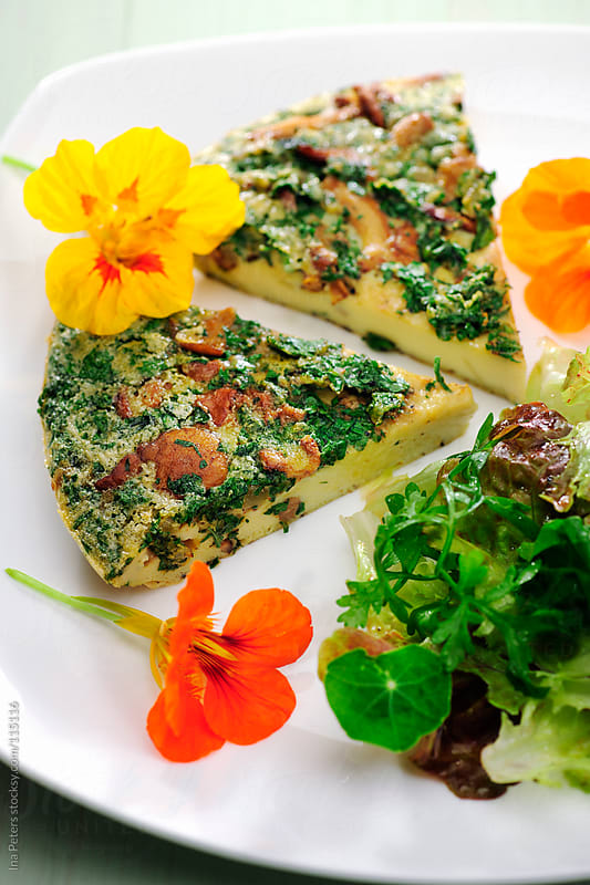 Food: Frittata with Chantarelles and Wild Herbs Salad by Ina Peters for Stocksy United