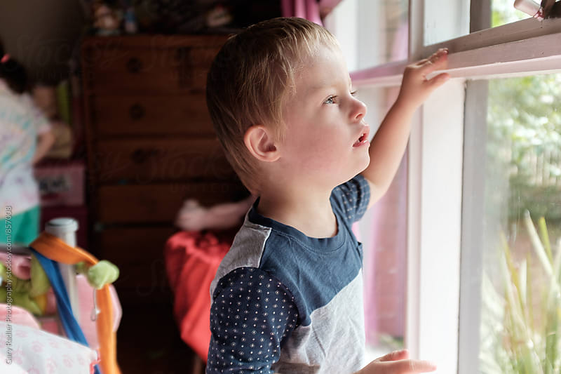 Little Boy at Bedroom Window by Gary Radler Photography for Stocksy United