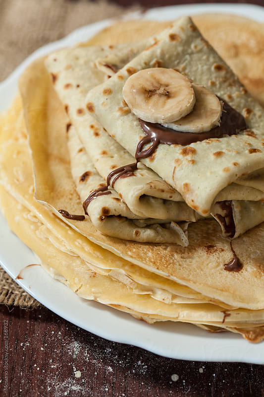 Homemade Crepes With Banana and Chocolate by Mosuno for Stocksy United