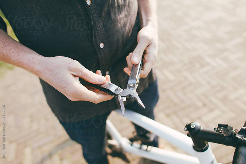 Holding a tool by Denni Van Huis for Stocksy United