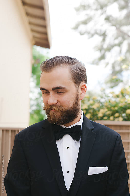 Young Man with Beard and Mustache Wearing  Suit by Caleb Thal for Stocksy United