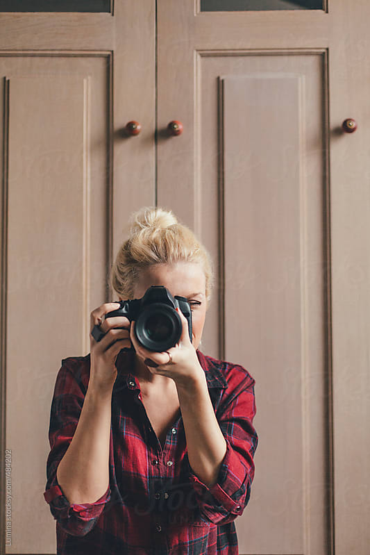 Blonde Woman Taking a Photo  by Lumina for Stocksy United