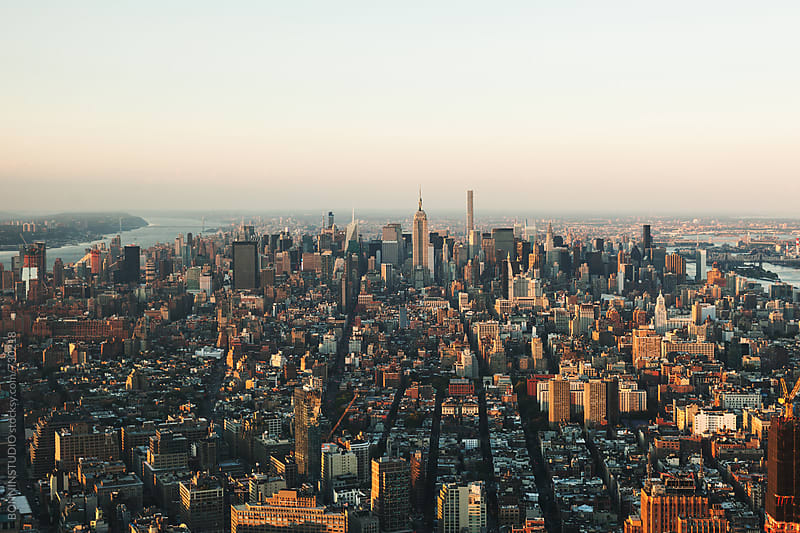 Views of Manhattan at sunset. by BONNINSTUDIO for Stocksy United
