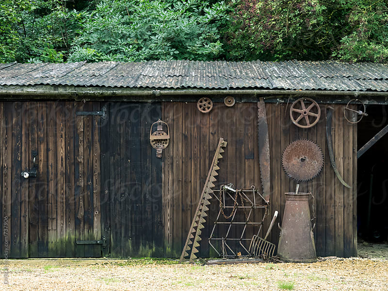Old wood sawmill with rusted tools on the wall by DV8OR for Stocksy United