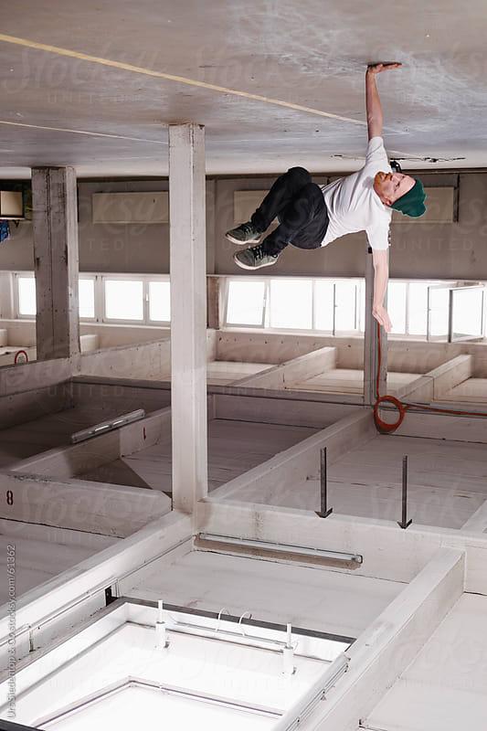 Break dancing man in industrial building by Urs Siedentop & Co for Stocksy United