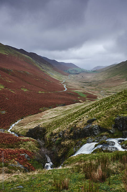 Moss Force waterfall and rain over Keskadale valley. Cumbria, UK. by Liam Grant for Stocksy United
