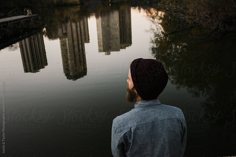 Man overlooking city by Isaiah & Taylor Photography for Stocksy United