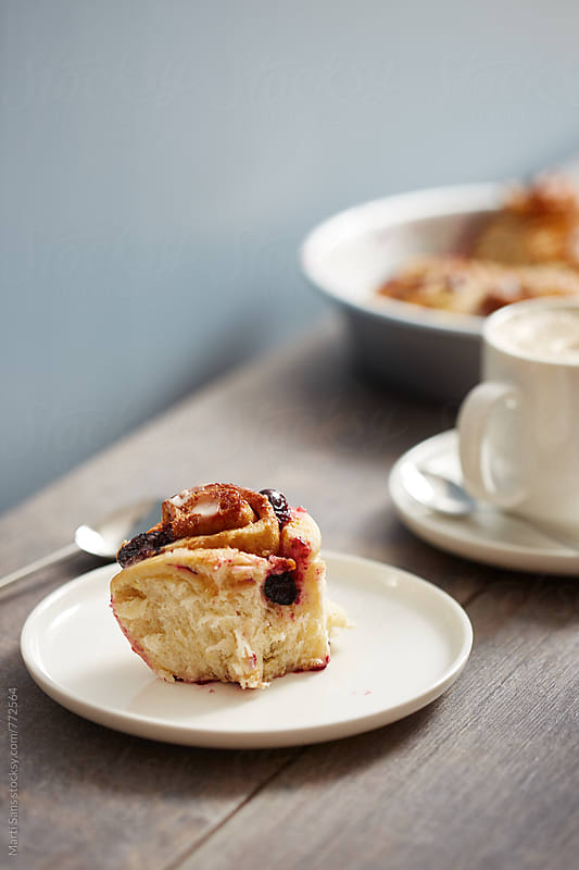 Blueberry roll breakfast with cappuccino by Martí Sans for Stocksy United