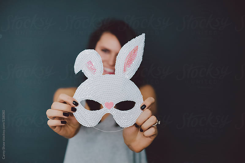 Woman holding bunny mask by Carey Shaw for Stocksy United
