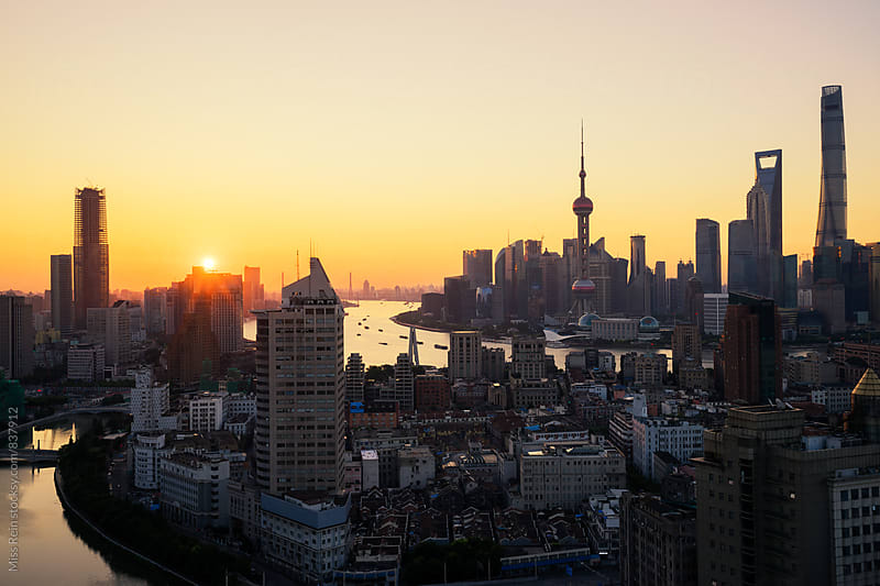 shanghai sunrise by Miss Rein for Stocksy United