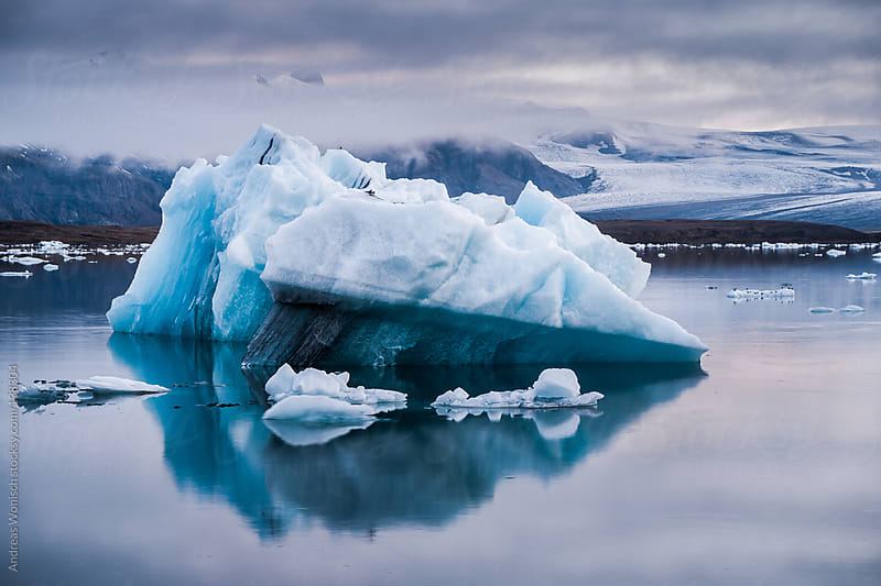 Iceberg floating in Glacier Lagoon by Andreas Wonisch for Stocksy United