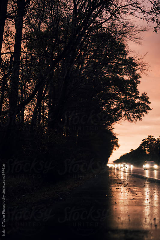 Colorful & wet road with car lights by Isaiah & Taylor Photography for Stocksy United