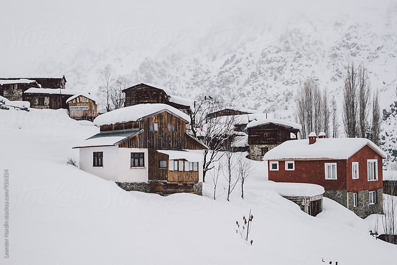 small mountain village with rural houses covered in snow, east anatolia, turkey by Leander Nardin for Stocksy United
