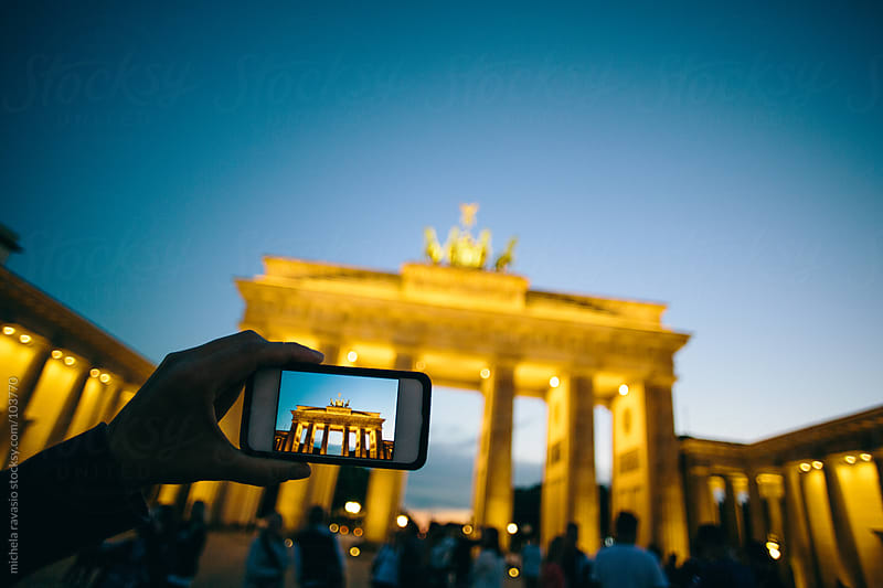 Woman photographing Brandenburg Gate in Berlin by michela ravasio for Stocksy United