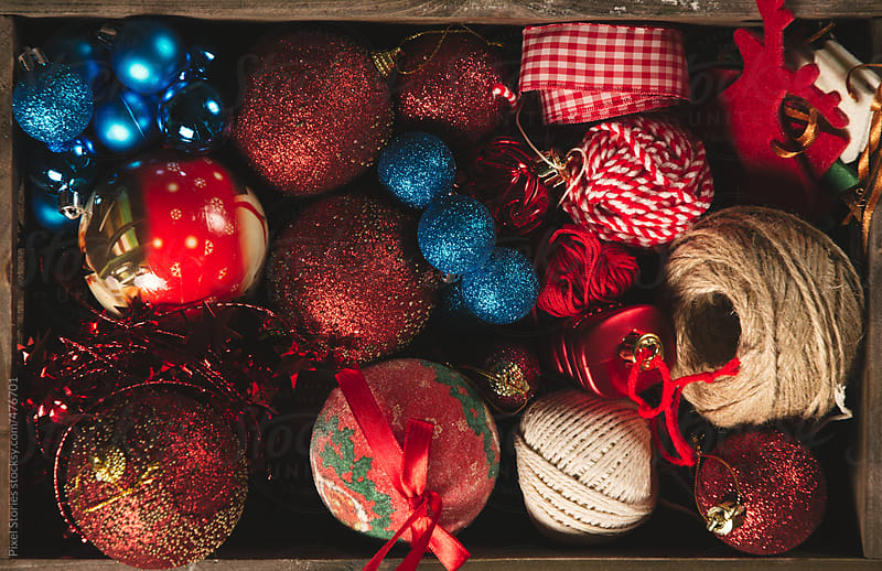 Crate full of Christmas ornaments by Pixel Stories for Stocksy United