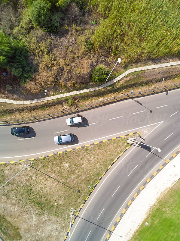 Aerial view of a freeway intersection by Luca Pierro for Stocksy United