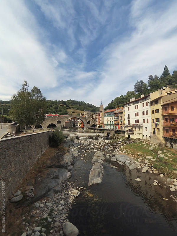 The medieval bridge over the River Ter at Camprodon, Spain by Bisual Studio for Stocksy United