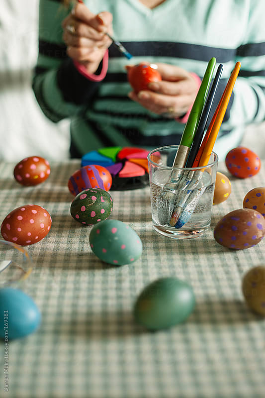 Woman painting eggs for Easter. by Darren Muir for Stocksy United