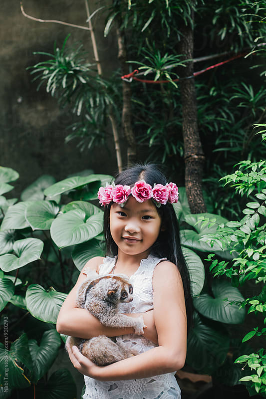 Girl portrait with wild animal by Nabi Tang for Stocksy United